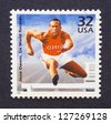 UNITED STATES - CIRCA 1998: postage stamp printed in USA showing an image of Jesse Owens, circa 1998. - stock photo