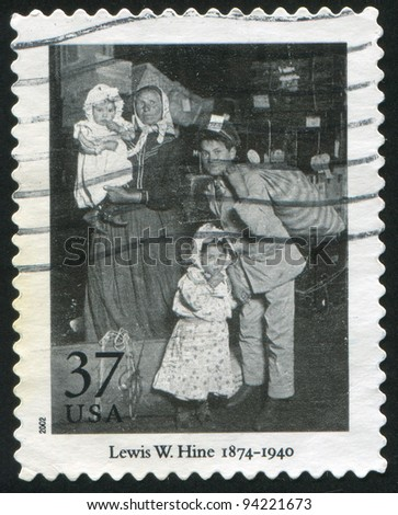UNITED STATES - CIRCA 2002: stamp printed by United States of America, shows 'Looking for Lost Luggage, Ellis Island' by Lewis W. Hine, circa 2002 - stock photo