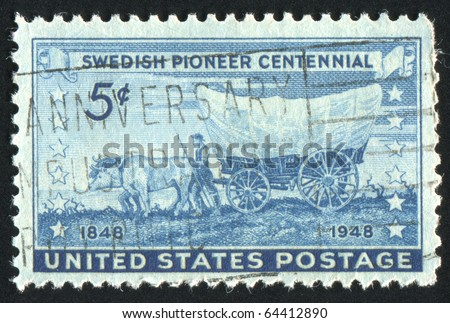 UNITED STATES - CIRCA 1948: stamp printed by United states, shows Swedish Pioneer with Covered Wagon Moving Westward, circa 1948 - stock photo