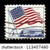 "UNITED STATES - CIRCA 1963: stamp printed in United states (USA), shows image of White House and American Flag, series ""Flag Issue"", circa 1963 - stock photo"