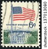 "UNITED STATES - CIRCA 1967: stamp printed in United states (USA), shows image of White House and American Flag, from series ""Flag Issue"", circa 1967 - stock photo"