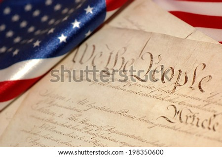 United States Constitution and American flag, SOFT FOCUS - stock photo