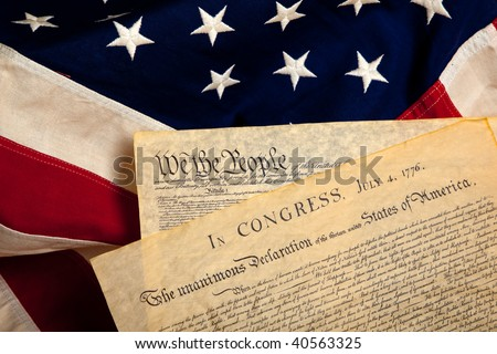 United States' Constitution and Declaration of Independence on a flag background - stock photo