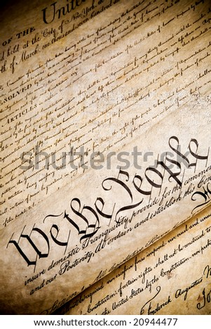 "United States Constitution with ""We The People"" on rough stone background - stock photo"
