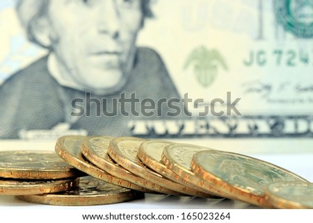 United States Currency Twenty Dollar Bill with Gold Coins - stock photo