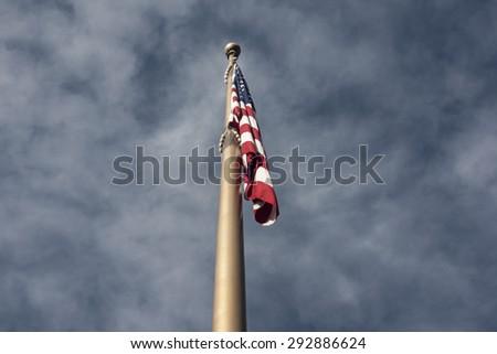 United States Flag on Flag Pole - stock photo