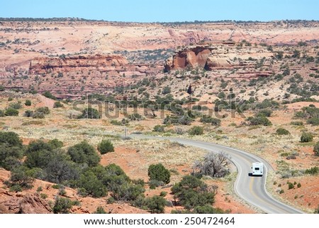 United States landscape - Canyonlands National Park in Utah. Island in the sky district - winding road with an RV. - stock photo