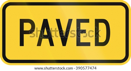 United States MUTCD warning road sign - Paved. - stock photo