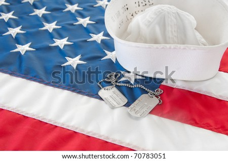 united states navy hat and dog tags - stock photo