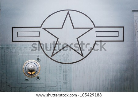 United States of America air force fighter plane detailed view of metal exterior with star symbol. - stock photo