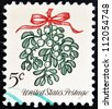 UNITED STATES OF AMERICA - CIRCA 1964: A Christmas postage stamp printed in USA shows mistletoe, circa 1964 - stock photo