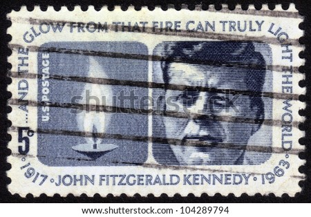 UNITED STATES OF AMERICA - CIRCA 1964: a stamp printed in the United States of America shows President  John Fitzgerald Kennedy (1917-1963) and Eternal Flame, circa 1964 - stock photo