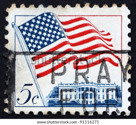 UNITED STATES OF AMERICA - CIRCA 1963: a stamp printed in the United States of America shows American Flag over White House, circa 1963