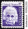UNITED STATES OF AMERICA - CIRCA 1965: a stamp printed in the United States of America shows Albert Einstein, theoretical physicist who developed the theory of general relativity, circa 1965 - stock photo