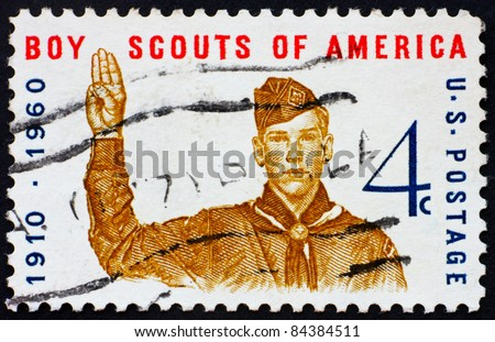 UNITED STATES OF AMERICA - CIRCA 1960: a stamp printed in the United States of America shows Boy scout giving scout sign, 50th anniversary of Boy scouts of America, circa 1960 - stock photo