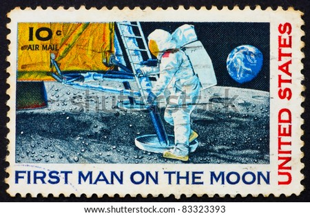 UNITED STATES OF AMERICA - CIRCA 1969: a stamp printed in the United States of America shows Man?s 1st landing on the moon, Apollo 11, circa 1969 - stock photo