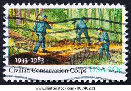 UNITED STATES OF AMERICA - CIRCA 1983: A stamp printed in the United States of America shows People Working in Forest, Civilian Conservation Corps, circa 1983 - stock photo