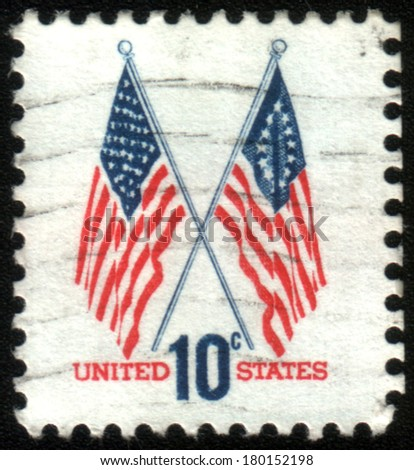 UNITED STATES OF AMERICA - CIRCA 1973: A stamp printed in the United States shows image of two US flags, series, circa 1973 - stock photo