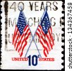 UNITED STATES OF AMERICA - CIRCA 1973: A stamp printed in the United States shows two US flags, circa 1973 - stock photo