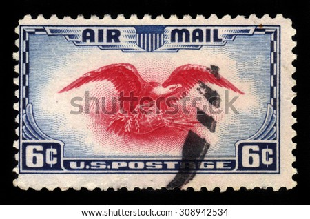 UNITED STATES OF AMERICA - CIRCA 1938: a stamp printed in the USA shows eagle holding shield, olive branch and arrows, circa 1938 - stock photo