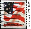 UNITED STATES OF AMERICA - CIRCA 2002: A stamp printed in the USA shows Flag, circa 2002 - stock photo
