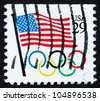 UNITED STATES OF AMERICA - CIRCA 1991: a stamp printed in the USA shows USA Flag and Olympic Rings, circa 1991 - stock photo