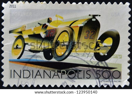UNITED STATES OF AMERICA - CIRCA 2011: A stamp printed in USA dedicated to Indianapolis, 100 years of racing, circa 2011 - stock photo