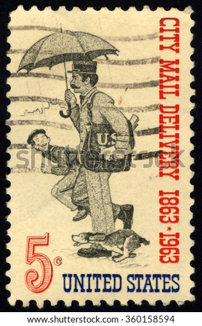 UNITED STATES OF AMERICA - CIRCA 1963: A stamp printed in USA dedicated to the Free City Mail Delivery Centenary shows Letter Carrier, circa 1963 - stock photo