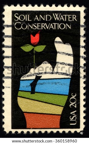UNITED STATES OF AMERICA - CIRCA 1950: A stamp printed in USA dedicated to the Soil and Water Conservation shows Flower in Hand, circa 1950. - stock photo