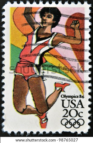 UNITED STATES OF AMERICA - CIRCA 1984: A stamp printed in USA from the Los Angeles Olympics 1984 issue, showing long jump, circa 1984.