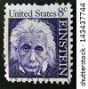 UNITED STATES OF AMERICA - CIRCA 1965: a stamp printed in USA shows Albert Einstein, theoretical physicist who developed the theory of general relativity, circa 1965 - stock photo