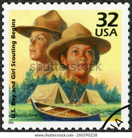 UNITED STATES OF AMERICA - CIRCA 1998: A stamp printed in USA shows Boy Scouts started in 1910, Girl Scouts formed in 1912, series Celebrate the Century, 1910s, circa 1998 - stock photo