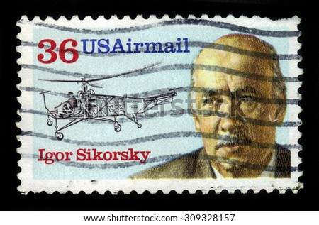 UNITED STATES OF AMERICA - CIRCA 1988: a stamp printed in USA shows Igor Sikorsky (1889-1972) and helicopter vought-sikorsky VS-300 of 1939, aeronautic engineer, series aviation pioneer, circa 1988