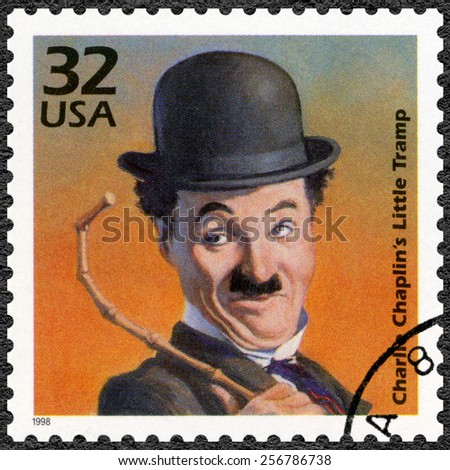 UNITED STATES OF AMERICA - CIRCA 1998: A stamp printed in USA shows portrait of Charlie Chaplin (1889-1977), series Celebrate the Century, 1910s, circa 1998 - stock photo