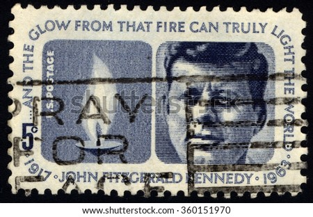 UNITED STATES OF AMERICA - CIRCA 1964: A stamp printed in USA shows Portrait of 35th President of USA - John Fitzgerald Kennedy and Eternal Flame, circa 1964 - stock photo