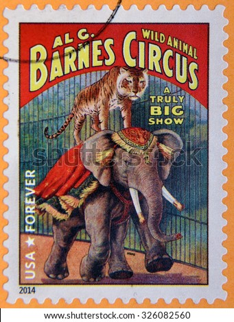 UNITED STATES OF AMERICA - CIRCA 2014: A stamp printed in USA shows tiger standing on elephant; wild animal Barnes circus; truly big show; circus vintage posters, circa 2014 - stock photo