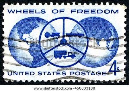 UNITED STATES OF AMERICA - CIRCA 1960: A used postage stamp from the United States of America, celebrating the Wheels of Freedom, circa 1960. - stock photo