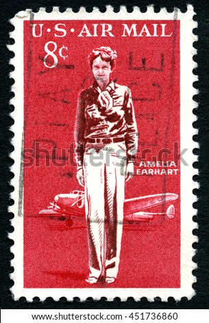 UNITED STATES OF AMERICA - CIRCA 1963: A used postage stamp from the USA celebrating American aviation pioneer Amelia Earhart, circa 1963. - stock photo