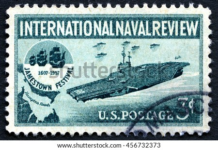 UNITED STATES OF AMERICA - CIRCA 1957: A used postage stamp from the USA, depicting an Aircraft Carrier and the Jamestown Festival logo commemorate the international Naval Review, circa 1957.