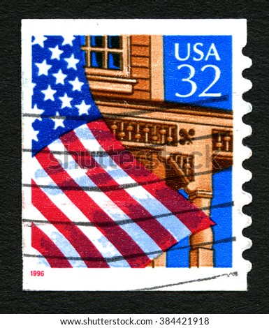 UNITED STATES OF AMERICA - CIRCA 1996: A used postage stamp printed in America, depicting an illustration of the American Flag outside a building, circa 1996. - stock photo