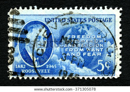 UNITED STATES OF AMERICA - CIRCA 1945: A used postage stamp printed in America, portraying an image of president Franklin D Roosevelt and a message of freedom, circa 1945. - stock photo