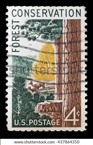 UNITED STATES OF AMERICA - CIRCA 1958: A used postage stamp printed in United States shows a glimpse of the forest with deer on a glade, circa 1958