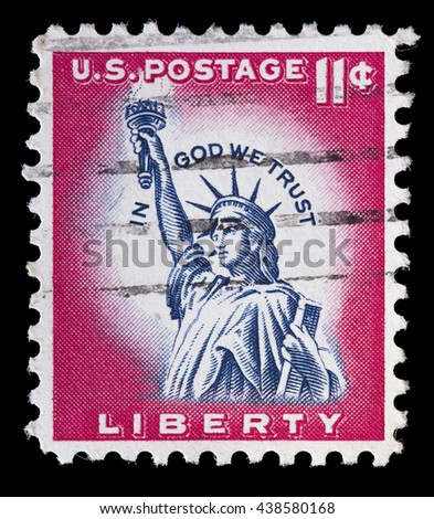UNITED STATES OF AMERICA - CIRCA 1961: A used postage stamp printed in United States shows the Statue of Liberty in blue on a red background, circa 1961 - stock photo