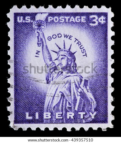 UNITED STATES OF AMERICA - CIRCA 1954: A used postage stamp printed in United States shows the Statue of Liberty on a violet background, circa 1954