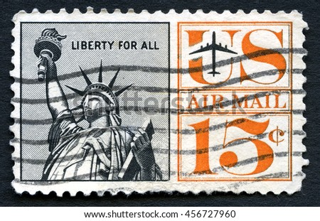 UNITED STATES OF AMERICA - CIRCA 1961: A used US air mail postage stamp depicting an illustration of the iconic Statue of Liberty, circa 1961. - stock photo