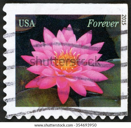 UNITED STATES OF AMERICA - CIRCA 2015: forever stamp printed in USA shows closeup of pink water lilies (waterlily); pink green; circa 2015 - stock photo