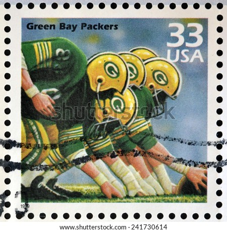 UNITED STATES OF AMERICA - CIRCA 1999: Stamp printed in USA dedicated to celebrate the century 1960s, shows green bay packers, circa 1999 - stock photo