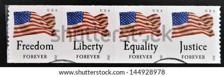 UNITED STATES OF AMERICA - CIRCA 2012: stamps printed in USA shows the image of the USA Flag, freedom, liberty, equality, justice, USA forever, circa 2012 - stock photo
