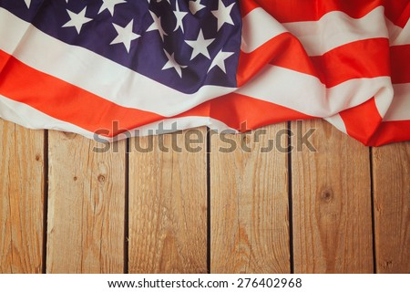 United States of America flag on wooden background. 4th of july celebration - stock photo