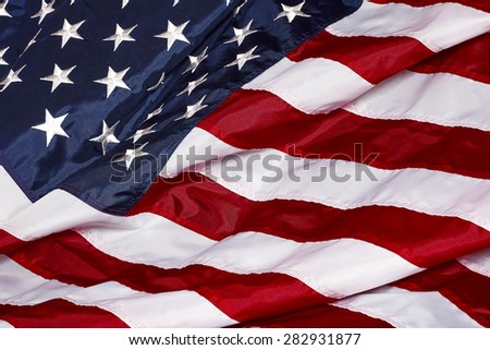 United States Of America Red White Blue Flag waving in the wind and sunlight closeup